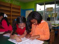 Aniya Hurse (right) gets a little help from friend Breana Reyes during homework hour at the Boys and Girls Club of Greater Dallas. The club's afterschool program runs from 3:30 p.m. to 7 p.m. and includes time for homework, a snack, exercise and art programs.Staff photos by ANANDA BOARDMAN