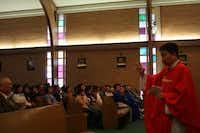 Fr. Vinh Trinh gives a sermon at Sunday mass at St. Peter Vietnamese Church.