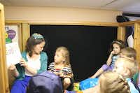 Zelony reads to 6-year-olds. Congregation Beth Torah has summer programs for children of all ages.Staff photos by SARAH SPELLINGS  -  neighborsgo