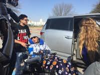 Alex Lemus helps his brother, Sergio Molina, into their van after Friday morning's hearing. Molina suffered brain damage after the deadly crash in 2013. (Tasha Tsiaperas / Staff)