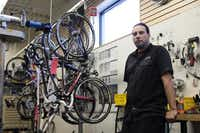 """Plano Cycling and Fitness bike mechanic Joe Spuckler said he wants to see better enforcement of laws designed to protect cyclists on the streets. """"You can get run off the road all the time,"""" Spuckler said. Although Plano was named the most bike-friendly city in Texas earlier this year by walkscore.com, bike commuters say cycling on Plano streets can be dangerous.Staff photos by CHRIS DERRETT"""