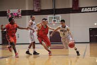 Rowlett senior Tristan Munoz drives into the lane against Garland Naaman Forest. Rowlett is now under the direction of head coach Jason Busch, who left Garland Lakeview Centennial to replace now-retired coach Stan Blackmon at Rowlett.Staff photo by CHRIS DERRETT
