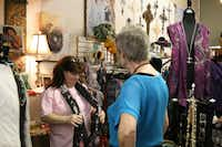 Ten of Arts co-owner Lynn Hosid helps Carrollton resident Patti Laurents during a busy Saturday afternoon in downtown Carrollton.