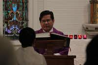 <TypographyTag12>Father Danilo Ramos </TypographyTag12>reads from the Bible to the congregation in the chapel at Sacred Heart Catholic Church.Staff photos by CHRIS DERRETT - neighborsgo