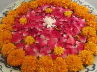 Bowls of marigolds make up a welcome puja, an offering often made to both the gods and special guests of Ananda.