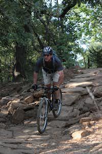 Fran Desautels navigates a rock hill on Murrell Park's Northshore Trail.