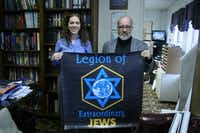 Deborah Fripp (left) and Geoffrey Dennis show off a banner for their fan organization within the Congregation Kol Ami synagogue. The Legion of Extraordinary Jews got its start in October 2012.Staff photo by DANIEL HOUSTON