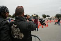 Motorcycle enthusiasts film the Coppell-Grapevine Police Motorcycle Rodeo. The event benefits several charities that support the families of fallen officers. Seventy riders from across Texas participated in the competition's events this year, which was nearly triple the rodeo's initial 25 competitors at the 2009 event.Meredith Shamburger - neighborsgo staff