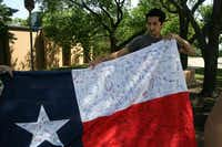 Alex Taylor holds a Texas flag that will be sent to Pope Francis as part of the student campaign to get him to speak at the school's 2015 graduation.Staff photo by MEREDITH SHAMBURGER - neighborsgo