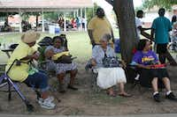 Irving residents and members of the West Irving Church include (from left) Ellen Claibourn, Aretha Young, Sandra Jackson and Katie Young, who watched the Juneteenth festivities recently at the Jackie Townsell Bear Creek Heritage Center  in Irving. The center works to display what life was like for black Americans from emancipation through the Civil Rights era.MEREDITH SHAMBURGER - neighborsgo staff
