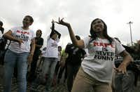 """Indonesian women dance as they take part in the """" One Billion Rising """" campaign, a worldwide call to end violence against women, on Valentine's Day in Jakarta, Indonesia, Thursday, Feb. 14, 2013. (AP Photo/Dita Alangkara)"""