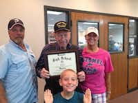 Futrell shows off the diploma he received from the Mesquite ISD trustees. With Futrell is his son, Greg (left), his daughter-in-law, Mary, and his great-grandson, Cayden.Photo submitted by THE FUTRELL FAMILY