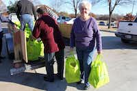 Glenda Stanford helps deliver bags of food at the Goodbar Senior Center at the Portable Pantry distribution day in December. The Portable Pantry Program is a partnership with Mesquite Senior Centers and Mesquite Social Services to help seniors receive food.Photos submitted by ALYSSA SMITH