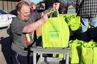 Keith Tackett helps unload the bags at the Portable Pantry drop off day in December.Photo submitted by ALYSSA SMITH