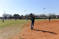 Faustino Coronado, 70, catches a ball during an Irving Eagles softball practice March 20 at Fritz Park in Irving. The Irving Eagles are a 65-and-older team that's been active in the Metroplex Senior Softball Association for 30 years.Rose Baca - neighborsgo staff photographer