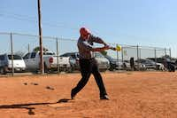 James Hyden, 76, takes a swing during an Irving Eagles softball practice on March 20, 2014 at Fritz Park in Irving. The Irving Eagles is a 65-and-older team that's been active in the Metroplex Senior Softball Association for 30 years.Rose Baca - neighborsgo staff photographer