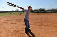 Dick Chaney, 80, warms up before stepping up to bat during an Irving Eagles softball practice on March 20, 2014 at Fritz Park in Irving. The Irving Eagles is a 65 and older team thatÕs been active in the Metroplex Senior Softball Association for 30 years.Rose Baca - neighborsgo staff photographer
