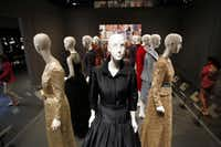 A section dedicated to dresses worn by first ladies features an evening gown worn by Laura Bush in 2007 (center) to greet President Nicolas Sarkozy of France at a social dinner.Ben Torres  -  Special Contributor