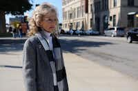 Cynthia Herschkowitsch stands at the spot she stood 50 years ago in downtown Dallas where she watched former President John F. Kennedy's motorcade go down Main Street.ROSE BACA