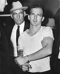 """Lee Harvey Oswald, escorted by Dallas police Detective Marlin G. """"Guy"""" Hall, was arrested on Nov. 22, 1963."""