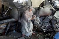 A Palestinian woman sits distraught in the wreckage of an apartment building hit by an Israeli airstrike in Gaza City.Tyler Hicks  -  The New York Times