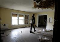 Randy Johnson walks through the apartment where Lee Harvey Oswald once lived at 600 Elsbeth St. in Oak Cliff.