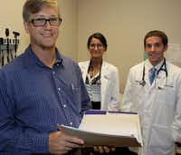 Justin Beatty of Denton, a first-year medical student at UT Southwestern, works at a free clinic in Dallas alongside Sonika Momin and Aaron Plitt.