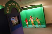 "At the Discovery Center Museum, the ""Get in the Game"" exhibit lets visitors stand in front of a green screen and play virtual sports games."
