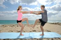Single-leg squats: Face partner and extend arms together; hold hands. Lift right foot while your partner lifts left foot until both of your thighs are parallel to the floor and your toes are touching. Squat with the other leg.