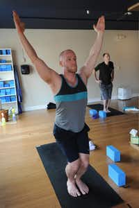 Brad Oister takes part in a yoga class for men at Anjali Yoga in Westmont, N.J.