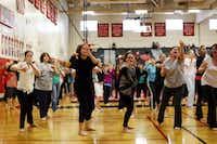 Women practiced scratching attackers during a class last week at Lake Highlands High School to teach women self-defense in lieu of the recent attacks on women in the Lake Highlands area of Dallas.Ian C. Bates - Staff Photographer