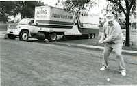 Golfers in this photo from 1987 had to deal with an unexpected obstacle on the edge of the ninth tee box at the Lakewood Country Club Golf Course. A moving van rolled out of the Lakewood Oaks Apartments. The drivers were calling on a person who was moving when the truck rolled400 feet across a street, crashing into a car, through a fence and over some crepe myrtles. No one was injured, and golfer James Peden didn't let it stop his game.DMN file photo