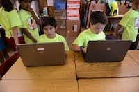 Fourth-grade students Cristian Cavazos (left) and Brooks Johnson work on an assignment.ROSE BACA  -  neighborsgo staff photographer