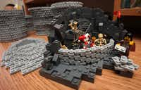Nannan Zhang's creation of someone being imprisoned on a desk in his LEGO workshop in Plano.