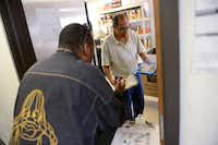 Volunteer Sammy Garza distributes food to Everett Joe Tatum at Lifenet. Lifenet also offers addiction therapy, food, clothing and employment resources. It also provides housing for the homeless to help them reach self-sufficency.ROSE BACA