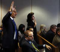 Attorneys for witness Lisa Blue (center) told the judge Dallas County DA Craig Watkins' office was under investigation.