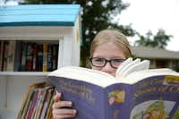 "Hannah Wahl, 11, is the steward of her Little Free Library on Malcolm Drive in Lakewood. The library works on the ""take a book, return a book"" philosophy, and it's the first of about six in the East Dallas area."