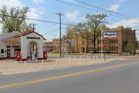 An old-fashioned Mobil gas station, preserved as it looked in the 1950s, is across the Little Rock Central High School.