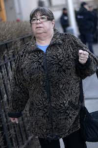Annette Bongiorno, a former employee at Bernard L. Madoff Investment Securities LLC, exits federal in New York, U.S., on Friday, March 21, 2014. The jury deciding the fate of five of Bernard Madoff's former employees charged with aiding his $17.5 billion Ponzi scheme will resume deliberations today with 11 members after one fell ill and was dismissed by a judge. Photographer: Louis Lanzano /Bloomberg *** Local Caption *** Annette BongiornoLouis Lanzano - Bloomberg