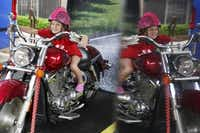 """Sophie Cocita, 5, of Dallas geared up for a motorcycle photo as the Texas Department of Transportation promoted the """"Share the Road: Look Twice for Motorcycles"""" campaign earlier this month at the Wildflower Art & Music Festival in Richardson.Andy Jacobsohn  -  Staff Photographer"""