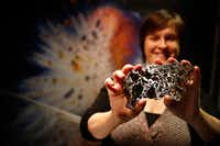 Meteorites from all over make their way to the Monnig Gallery. Curator Rhiannon Mayne shows a cross section of one that was found in Durango, Mexico.