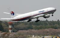 A Malaysia Airlines Boeing 777-200ER similar to the one that lost contact on a flight from Kuala Lumpur to Beijing. takes off from Narita Airport near Tokyo.