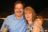 In this undated photo provided by Mark Sherlach, Mark Sherlach and his wife, school psychologist Mary Sherlach, pose for a photo. Mary Sherlach was killed Friday, Dec. 14, 2012, when a gunman opened fire at Sandy Hook Elementary School, in Newtown, Conn., killing 26 children and adults at the school. (AP Photo/Courtesy of Mark Sherlach)uncredited - AP