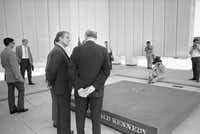 Sargent Shriver, brother-in-law of Kennedys, left, chats with Dallas Mayor Erik Jonsson, back to camera, at the John F. Kennedy Memorial Plaza in Dallas, June 27, 1970. Shriver was the first member of the Kennedy family to visit the plaza, erected near the site of President John F. Kennedy's assassination.