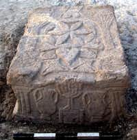 A handout picture released on September 11, 2009 by the Israel Antiquities Authority shows a stone engraved with a seven-branched menorah (candelabrum) at the site where a synagogue from the Second Temple period (50 BCE-100 CE) was discovered at Migdal beach, near Nazareth. The synagogue that was uncovered joins just six other synagogues in the world that are known to date to the Second Temple period.- -  AFP/Getty Images