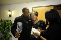 Church members comfort each other in the wake of Price's death. Price grew his church from 20 members to 2,000.