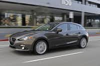 The 2014 Mazda3 Grand Touring is as pure of a Mazda as we have seen in a decade, now that the Japanese automaker is no longer linked to Ford and Volvo.