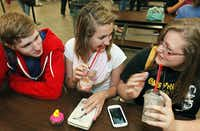 Colony High students (from left) Connor Harvey, Maddie Lustig and Jasmine Contreras gathered over bistro-style drinks available at The Cafe in the school cafeteria.
