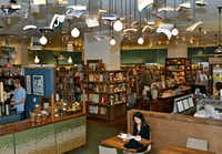 McNally Jackson Books has a cheery upstairs cafe — complete with books artfully hanging from the ceiling.