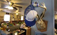 """Eclectic decor including a jackalope and a """"give me hat"""" at The Mecca Restaurant in Dallas."""